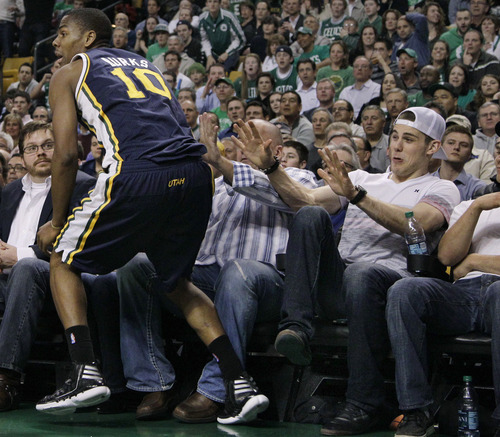 Elise Amendola     The Associated Press  Boston Bruins hockey player Tyler Seguin, right, puts his hands up as Utah Jazz guard Alec Burks (10) runs close to the fans to retrieve the ball in the second half of an NBA basketball game against the Boston Celtics in Boston on Wednesday. The Celtics won 94-82.