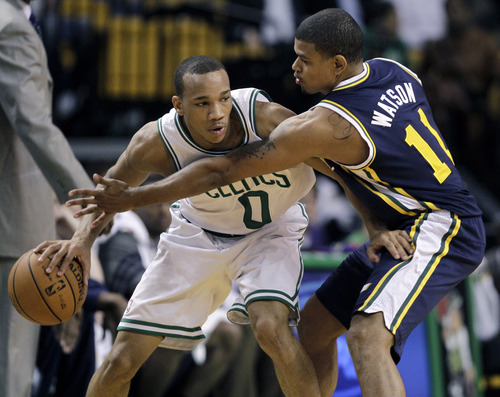 Elise Amendola     The Associated Press  Utah Jazz guard Earl Watson (11) defends Boston Celtics guard Avery Bradley (0) in the first half of an NBA basketball game in Boston on Wednesday.