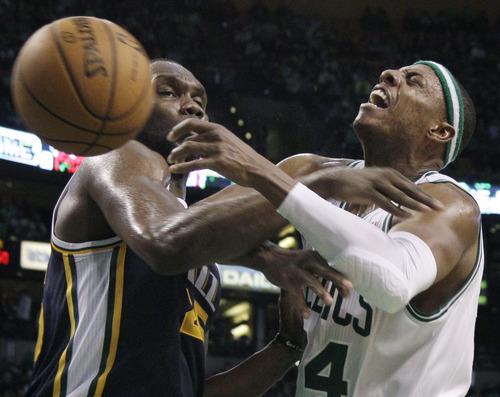 Elise Amendola     The Associated Press  Utah Jazz center Al Jefferson, left, knocks the ball away from Boston Celtics forward Paul Pierce in the second half of an NBA basketball game in Boston on Wednesday.