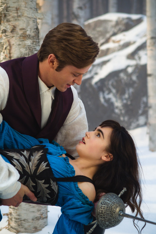 In this film image released by Relativity Media, Armie Hammer and  Lily Collins are shown in a scene from,