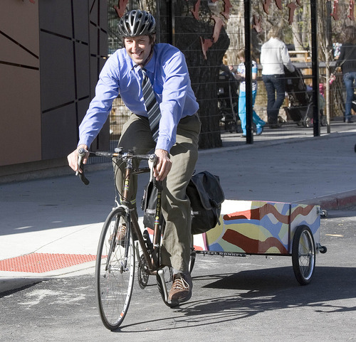 Paul Fraughton   The Salt Lake Tribune Phil Sarnoff, of the Salt Lake Division of Sustainability, rides his bike in Liberty Park, towing a wagon that he uses to carry support materials to promote the City's SmartTrips program. The program held its kickoff event outside Tracy Aviary on Wednesday, March 28, 2012.