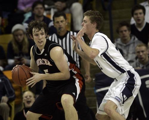 Kim Raff | The Salt Lake Tribune Utah State player Brady Jardine defends Mercer player Bud Thomas during the CIT Championship game at Utah State University in Logan, Utah on March 28, 2012.
