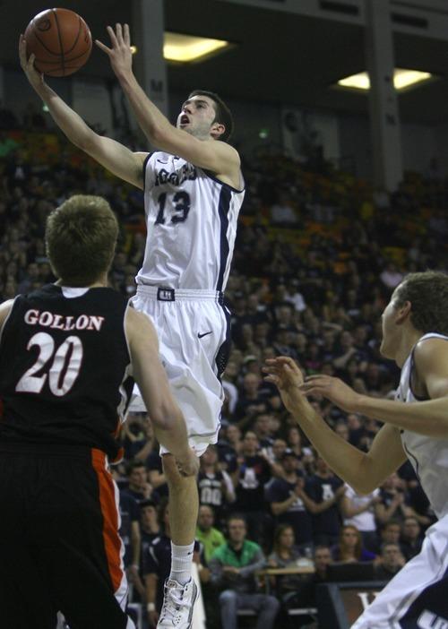 Kim Raff | The Salt Lake Tribune Utah State University player Preston Medlin attempts a layup as Mercer player Jakob Gollon defends during the CIT Championship game at Utah State University in Logan, Utah on March 28, 2012.