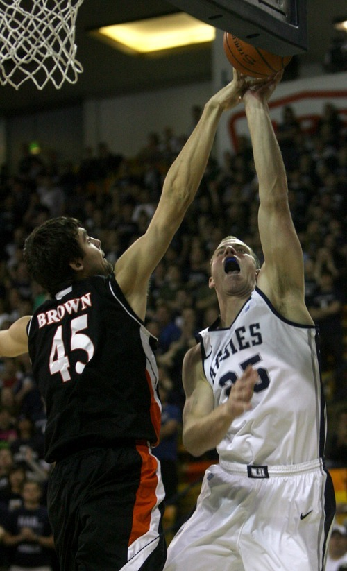 Kim Raff | The Salt Lake Tribune Utah State University Jordan Stone attempts a layup as Mercer player Monty Brown gets a finger on the ball during the CIT Championship game at Utah State University in Logan, Utah on March 28, 2012.  Mercer went on to win the game 67-70.