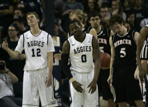 Kim Raff | The Salt Lake Tribune Utah State University players react to a call against them during a game against Mercer during the CIT Championship game at Utah State University in Logan, Utah on March 28, 2012.  Mercer went on to win 70-67.