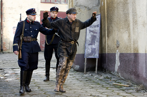 Robert Wieckiewicz , right, plays Leopold Socha, a Polish sewer worker who worked to protect Jews during the Nazi occupation of Poland, depicted in the drama