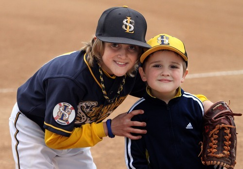 Rick Egan    The Salt Lake Tribune   Baylor Jeppsen, with his 4-year-old brother Crew Jeppsen at the baseball park in South Jordan on Wednesday, March 28, 2012. Crew has autism.