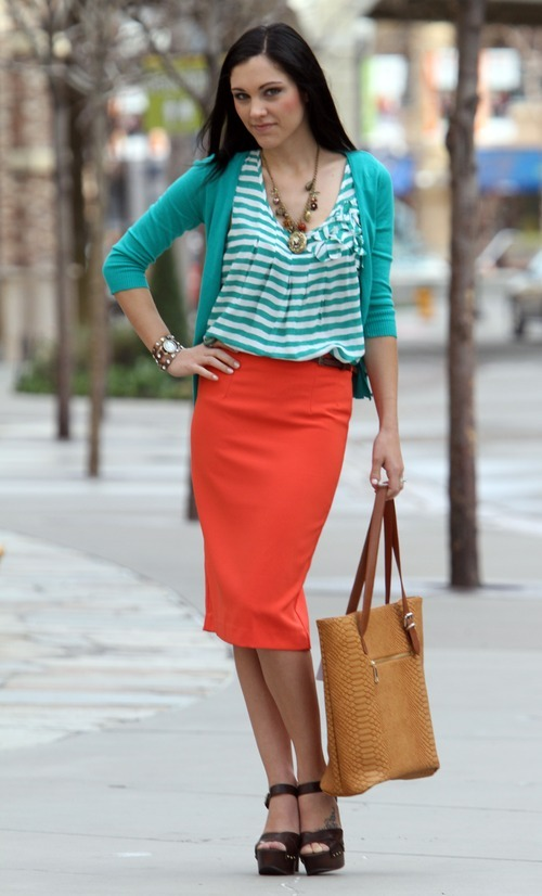 Rick Egan    The Salt Lake Tribune   Model Shay Williamson wears complementary colors of orange and teal. Clothing includes a Blu Peper teal striped top, $34.50; Active Basic teal cardigan, $38.50; Alythea coral skirt with belt, $38.50; Bohme sandal, $38.50; Bohme camel tote, $58.50; and Bohme necklace, $18.50. All clothing from Bohme Boutique.