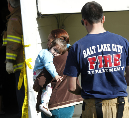 Al Hartmann  |  The Salt Lake Tribune It was a long night and morning for renters at an apartment complex at 400 North and Redwood Road. Salt Lake City Fire Department and police allowed some of the 140 renters to remove clothes and valuables Thursday morning from their smoke-damaged apartment building.