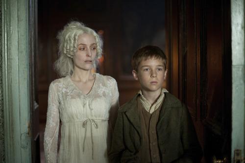 Gillian Anderson as Miss Havisham and Oscar Kennedy as young Pip. Courtesy Nicola Dove  |  BBC for MASTERPIECE