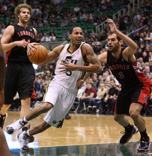 Steve Griffin  |  The Salt Lake Tribune   Utah's Devin Harris drives the ball past Jose Calderon during a game against the Raptors game at EnergySolutions Arena in Salt Lake City on Wednesday, Jan. 25, 2012.