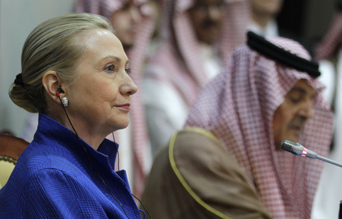 US Secretary of State Hillary Rodham Clinton, left, listens to Saudi Foreign Minister Prince Saudi al-Faisal, right, during a press conference after her meeting with the foreign ministers of the Gulf Cooperation Council