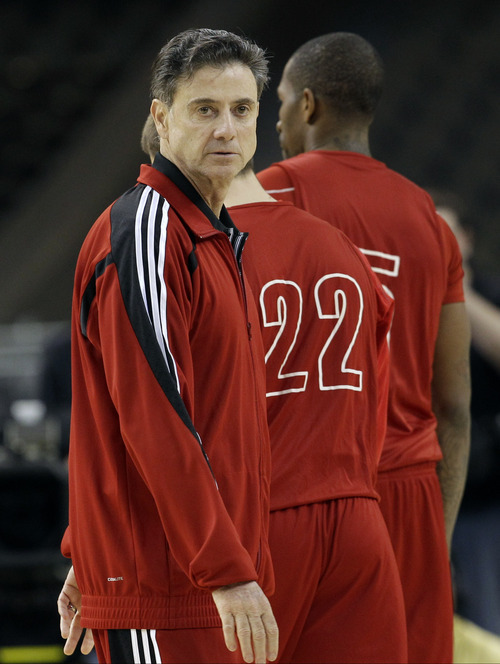 Louisville head coach Rick Pitino watches his team during a practice session for the NCAA Final Four basketball tournament Friday, March 30, 2012, in New Orleans. Louisville plays Kentucky in a semifinals game on Saturday. (AP Photo/David J. Phillip)