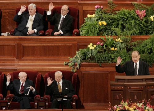 President Thomas S. Monson (right), along with (clockwise from Monson) President James E. Faust, President Gordon B. Hinckley, Presiding Bishop H. David Burton, and Keith McMullin (Burton's second counselor), raise their hands to sustain the general authorities of the church. LDS General Conference Saturday AM session, Conference Center, Salt Lake City. Photo by Trent Nelson, 4.01.2006