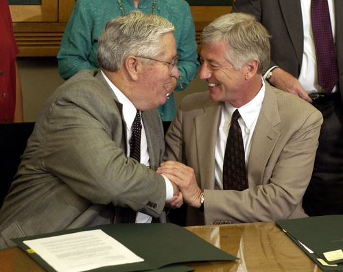 H. David Burton (left), LDS presiding bishop, and Salt Lake City Mayor Rocky Anderson shake hands after signing closing documents on the Main Street Plaza land swap deal July 28, 2003, at Salt Lake City Hall. In the deal the city signed over the public access easement on the plaza to the church and the church signed off on land in the Glendale area giving it to the city. Griffin/photo