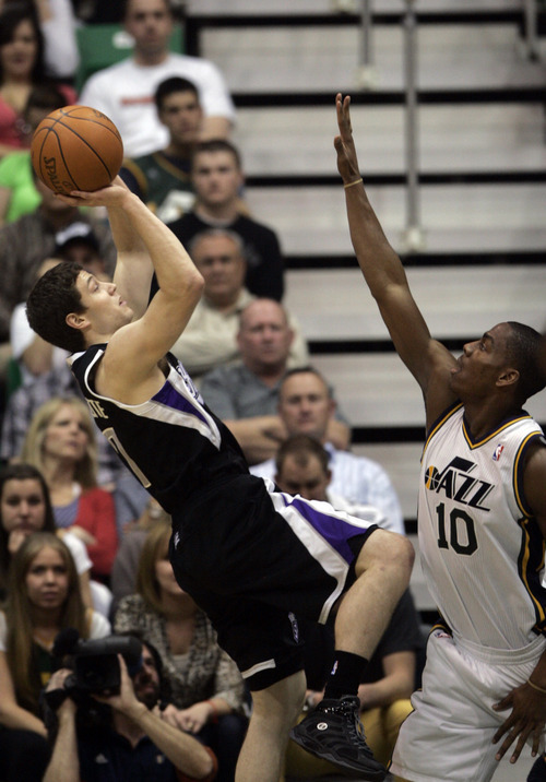 Kim Raff | The Salt Lake Tribune Jazz player Alec Burks defends as Kings player Jimmer Fredette takes a shot during a game at EnergySolutions Arena in Salt Lake City, Utah on March 30, 2012. The Jazz went on to lose the game 103-104.
