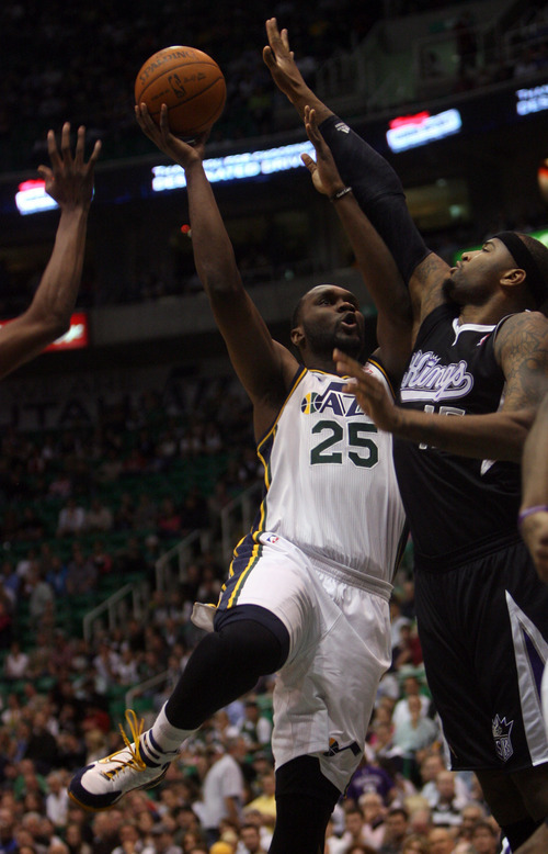 Kim Raff | The Salt Lake Tribune Jazz player Al Jefferson attempts a field goal as Kings player Demarcus Cousins defends during the first quarter a game at EnergySolutions Arena in Salt Lake City, Utah on March 30, 2012.