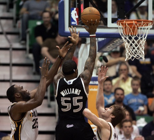 Kim Raff | The Salt Lake Tribune Jazz players (left) Al Jefferson and Gordan Hayward defend Kings player Terrance Williams as he attempts a field goal during a game at EnergySolutions Arena in Salt Lake City, Utah on March 30, 2012. The Jazz went on to lose the game 103-104.