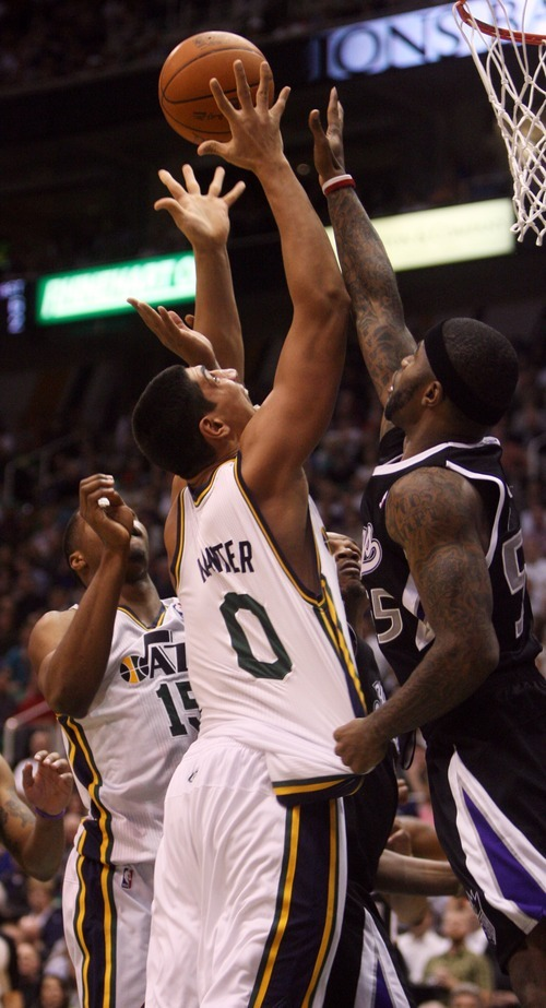 Kim Raff | The Salt Lake Tribune Jazz player Enes Kanter tries to hang onto the ball as Kings player Terrence Williams put pressure on him during a game at EnergySolutions Arena in Salt Lake City, Utah on March 30, 2012. The Jazz went on to lose the game 103-104.