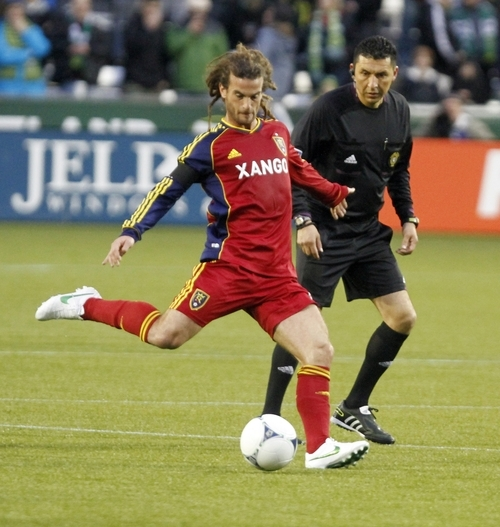 Real Salt Lake midfielder Kyle Beckerman takes a shot on goal during the first half of their MLS soccer game against the Portland Timbers in Portland, Ore., Saturday, March 31, 2012.  Beckerman scored the winning goal as they beat the Timbers 3-2.(AP Photo/Don Ryan)