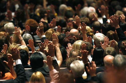 Scott Sommerdorf  |  The Salt Lake Tribune              Conference  attendees signify their agreement with proposed leadership changes within the general authorities, the Presiding Bishopric and Relief Society Presidency at the 182nd Annual General Conference of The Church of Jesus Christ of Latter-day Saints on Saturday.
