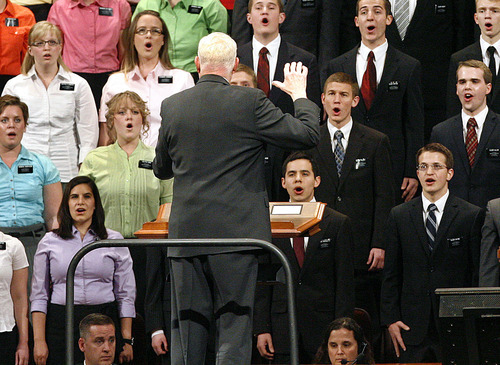 Scott Sommerdorf     The Salt Lake Tribune              'American Idol' star David Archuleta, seen just under music director Mack Wilberg's elbow, sings along with other missionaries at the 182nd Annual General Conference of The Church of Jesus Christ of Latter-day Saints on Saturday.