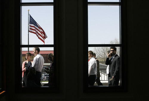Scott Sommerdorf  |  The Salt Lake Tribune              People file past the Conference Center windows as they wait to be admitted to the 182nd Annual General Conference of The Church of Jesus Christ of Latter-day Saints on Saturday.