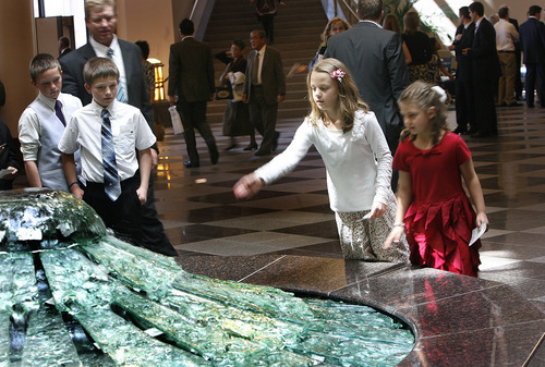 Scott Sommerdorf  |  The Salt Lake Tribune              Children watch as a young girl tosses a coin into a fountain while attending the afternoon session of the 182nd Annual General Conference of The Church of Jesus Christ of Latter-day Saints on Saturday.