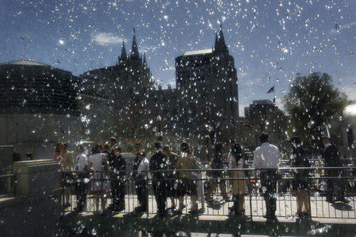 Scott Sommerdorf  |  The Salt Lake Tribune              Conferencegoers file past the Salt Lake Temple and the waterfall at the Conference Center while waiting in line to attend the afternoon session of the 182nd Annual General Conference of The Church of Jesus Christ of Latter-day Saints on Saturday.