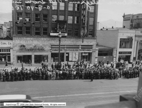 Photo courtesy Utah State Historical Society  Image shows a crowd gathered to watch the