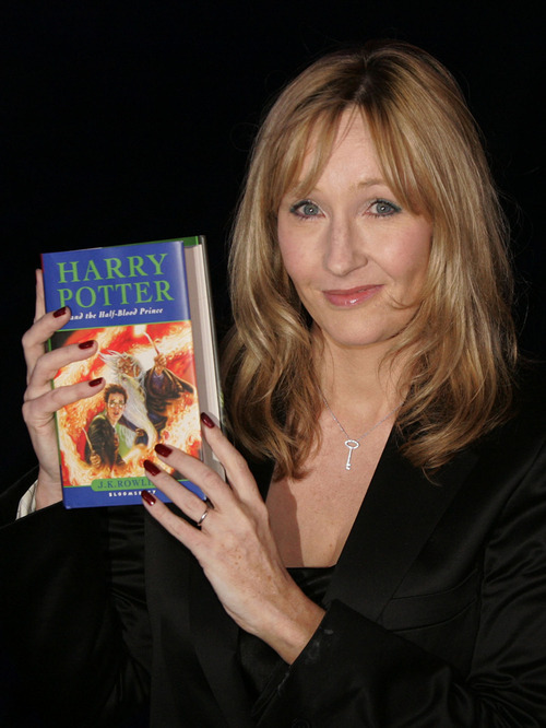 In this  Friday, July 15, 2005 file photo shows British author J.K. Rowling holding a copy of her latest book 'Harry Potter and the Half-Blood Prince' as she arrives at Edinburgh Castle in Edinburgh, Scotland, for its world wide launch.  At last, Harry Potter's adventures are available electronically. The seven novels about J.K. Rowling's boy wizard are for sale as e-books and audio books on the author's Pottermore website, the site's creators announced Tuesday March 27, 2012. The books are available only through the website, which says they are compatible with major electronic e-readers, including Amazon's Kindle and Sony's Reader, as well as with tablets and mobile phones.  (AP Photo/Matt Dunham, File)