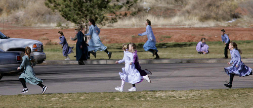 Girls run and play during a 2006 recess at an FLDS private school in Hildale. Those schools were later closed in favor of children being educated solely at home.  Photo by Trent Nelson.