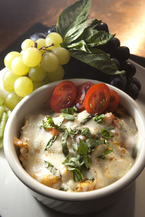 Leah Hogsten  |  The Salt Lake Tribune At Harley and Buck's in Eden, chef/owner Craig Bonham takes ingredients for a traditional caprese salad -- tomatoes, fresh basil and mozzarella -- and creates a baked egg frittata.