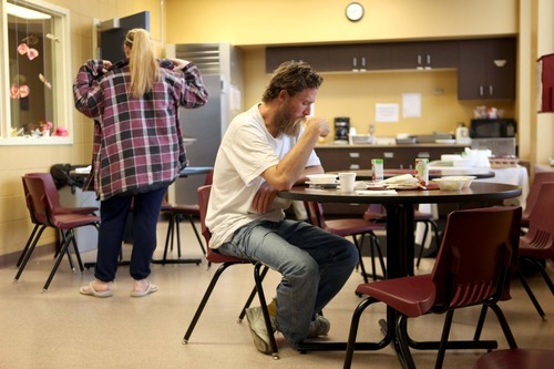 Tribune file photo In Tacoma, Wash., Recovery Response Center guest Ben, right, has a meal in the center's central lounge area. The center is a model for the one opening in Salt Lake County in June. Cliff DesPeaux     Special to the Tribune)