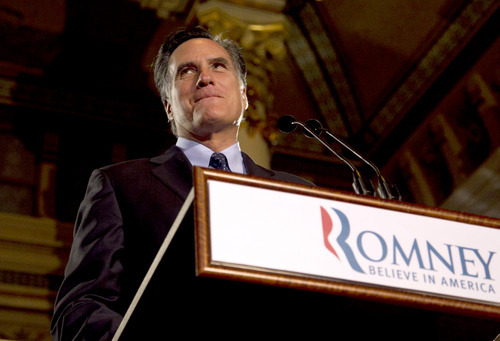 Republican presidential candidate, former Massachusetts Gov. Mitt Romney pauses while speaking at a primary election night rally in Milwaukee, Tuesday, April 3, 2012, after he won the Wisconsin Republican presidential primary. (AP Photo/Steven Senne)