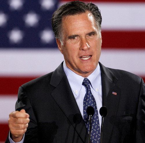 Republican presidential candidate, former Massachusetts Gov. Mitt Romney declares victory in the Wisconsin presidential primary at the Grain Exchange, Tuesday, April 3, 2012, in Milwaukee. (AP Photo/M. Spencer Green)