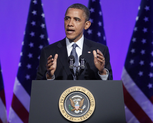 President Barack Obama gestures as he speaks at The Associated Press luncheon during the ASNE Convention, Tuesday, April 3, 2012, in Washington.  (AP Photo/Pablo Martinez Monsivais)