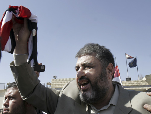 FILE - In this Thursday, March 3, 2011 file photo, Khayrat el-Shater, the lead strategist for Egypt's largest opposition group, waves by Egyptian flag after being released from Tora prison in Cairo, Egypt. Trying to unite divided Islamists behind him, the presidential hopeful of Egypt's Muslim Brotherhood has promised to give religious clerics power to review legislation to ensure it is in line with Islamic law, a group of ultraconservative Muslim clerics said Wednesday. Brotherhood candidate Khairat el-Shater is trying to avert a split in the votes of religious conservatives in next month's presidential election. The Brotherhood is Egypt's strongest fundamentalist group, but several other Islamists are running in the vote _ particularly Hazem Abu Ismail, who has strong support among Salafis, the most hard-line religious movement in Egypt. (AP Photo/Mohammed Abu Zaid, File)
