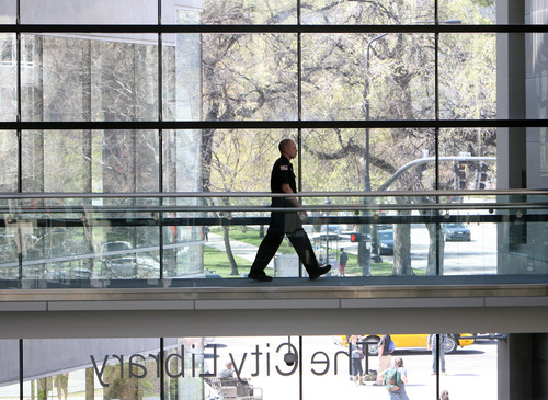 Steve Griffin/The Salt Lake Tribune   Shaun Cross, a CBI Security officer, keeps an eye on things at the Salt Lake City Main Library in Salt Lake City Tuesday April 3, 2012. CBI handles the security needs at the library.