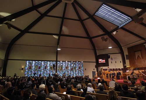 Mourners listen as Oakland Mayor Jean Quan makes a statement during a memorial service at the Allen Temple Baptist Church Tuesday, April 3, 2012, in Oakland, Calif. Several hundred people gathered Tuesday night for a prayer vigil for the victims of Monday's shooting at Oikos University, a small Christian school in Oakland. (AP Photo/Ben Margot)