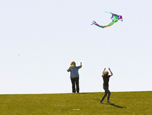 Paul Fraughton   The Salt Lake Tribune  Maggie Nickerson, left, and her daughter Rebecca launch their kite into the breezes blowing in Salt Lake's Sugarhouse Park on Wednesday, April 4, 2012.