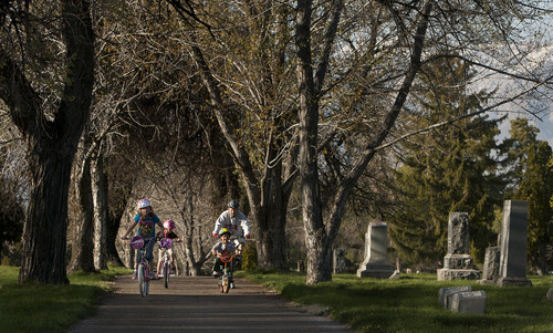 Leah Hogsten     The Salt Lake Tribune Ben Stephen of Ogden strolls leisurely through Leavitt's Memorial Park on his bike with his children, from left: Audrey, 8, Marissa, 6, and Trent, 4. Wednesday's balmy weather will move out for a storm on Thursday, but sunny skies and warmer temperatures should return for Easter weekend.