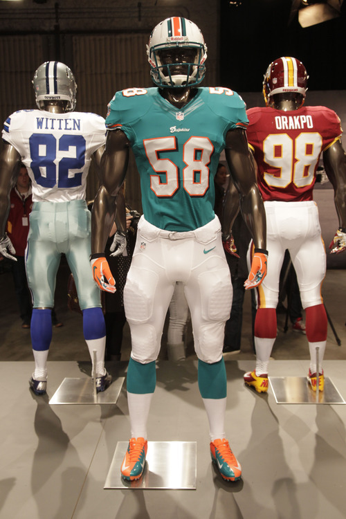The new Miami Dolphins uniform is displayed on a mannequin in New York 4d199e894