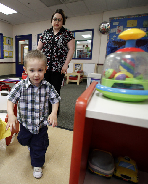 In this April 4, 2012, photo, Kelly Andrus follows her son Bradley as he runs through a classroom at Children's Choice Learning Centers Inc., where Bradley attends in Lewisville, Texas. Bradley, who turns three in a couple of weeks, was diagnosed a year ago with mild autism. For the first time in nearly two decades, experts want to rewrite the definition of autism. Some parents fear that if it's narrowed and their kids lose the label, they may also lose out on special therapist. (AP Photo/Tony Gutierrez)
