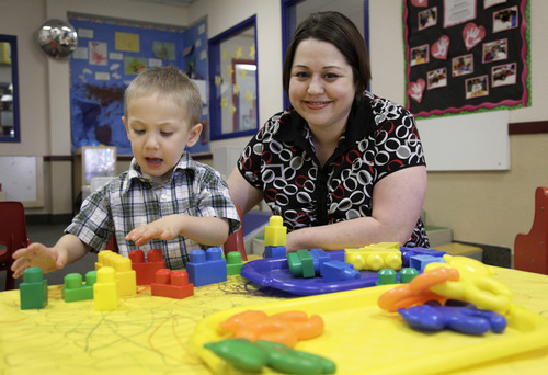 In this April 4, 2012, photo, Kelly Andrus plays with her son Bradley, in his classroom at Children's Choice Learning Centers Inc., in Lewisville, Texas. Bradley, who turns three in a couple of weeks, was diagnosed a year ago with mild autism.  For the first time in nearly two decades, experts want to rewrite the definition of autism. Some parents fear that if it's narrowed and their kids lose the label, they may also lose out on special therapist. (AP Photo/Tony Gutierrez)