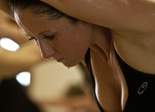 Leah Hogsten  |  The Salt Lake Tribune Sweat drips off Debi Muir as the 90-minute class winds down. Students of Bikram Yoga in Sandy sweat through 26 postures and two breathing exercises in 90 minutes under the watchful eye of instructor Jackie Wheeler.