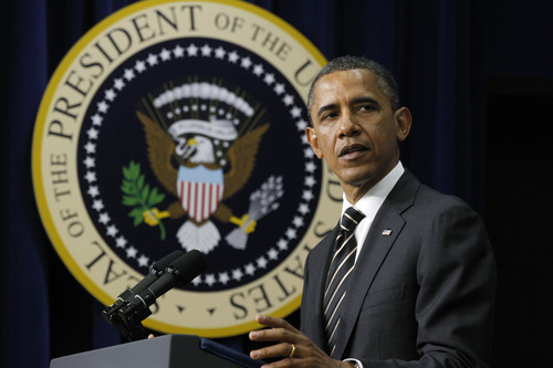 President Barack Obama speaks  in the Eisenhower Executive Office Building across from the White House in Washington, Wednesday, April 4, 2012, before he signed the Stop Trading on Congressional Knowledge (STOCK) Act. (AP Photo/Charles Dharapak)