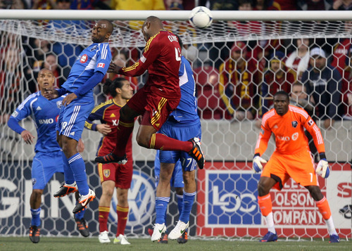Steve Griffin/The Salt Lake Tribune   RSL's Jamison Olave leaps into the air as he heads the ball toward the goal during the RSL versus Montreal soccer game at Rio Tinto Stadium in Sandy Wednesday April 4, 2012.