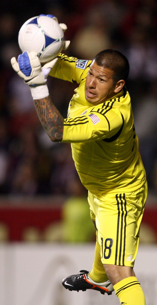 Steve Griffin/The Salt Lake Tribune   RSL goal keeper Nick Rimando makes a diving stop during the RSL versus Montreal soccer game at Rio Tinto Stadium in Sandy Wednesday April 4, 2012.