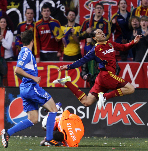 Steve Griffin/The Salt Lake Tribune   RSL's Fabian Espindola leaps over Montreal goal keeper Donovan Ricketts who made a sliding stop on the ball during the RSL versus Montreal soccer game at Rio Tinto Stadium in Sandy Wednesday April 4, 2012.